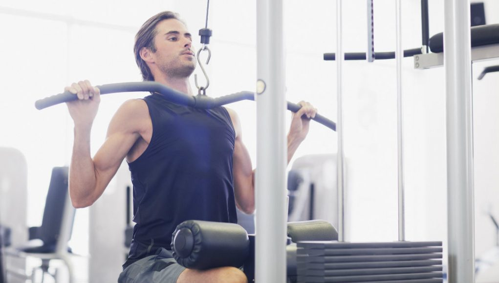 Handsome man exercise with dumbbell in the gym