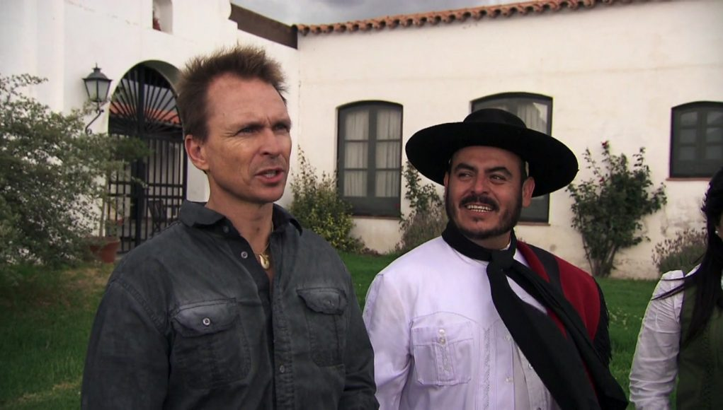 Phil Keoghan standing in front of a building