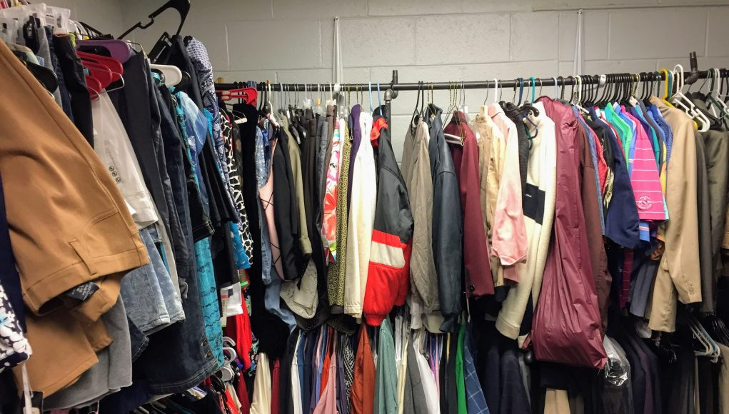 A bunch of clothes hanging on a rack
