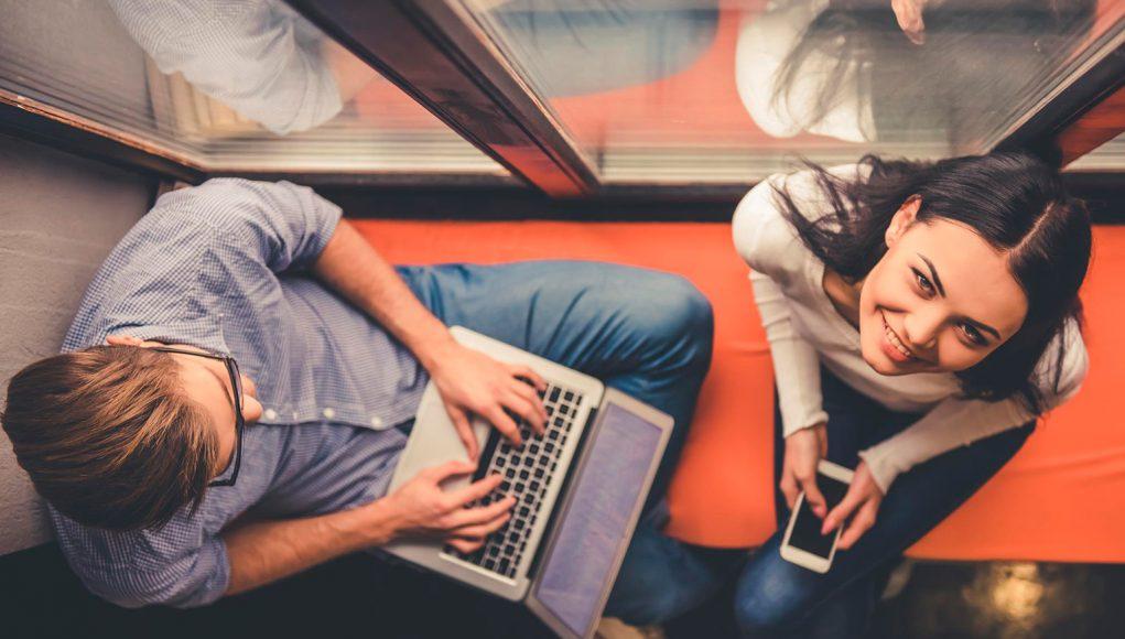 A man lying on a laptop